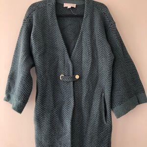 Emerald green wrap sweater with gold buttons